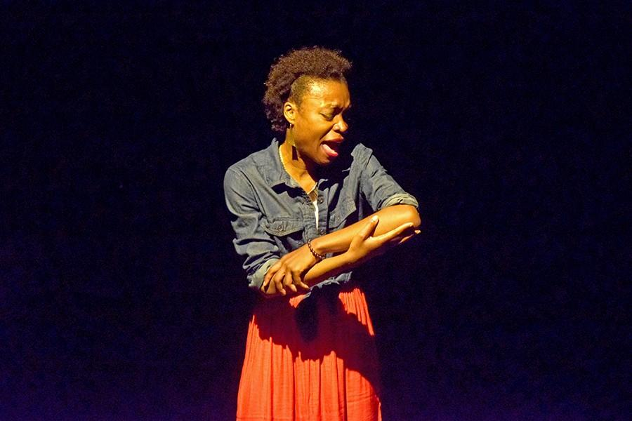 "Performer Echo Brown, shifts into her final scene with a climatic flow of movements  in her original one -person play, ""Black Virgins Are Not For Hipsters,"" on March 1 in the Knox Center."