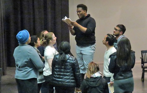 "Drama major Armond Lee (center) reads to his fellow actors during a rehearsal of ""The Laramie Project"" in the Knox Center on Friday."