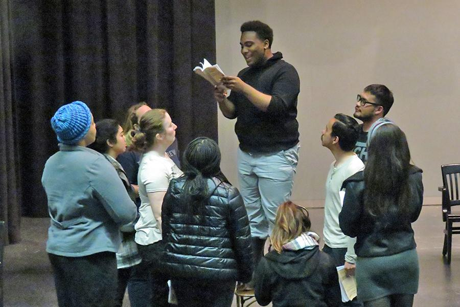 """Drama major Armond Lee (center) reads to his fellow actors during a rehearsal of """"The Laramie Project"""" in the Knox Center on Friday."""