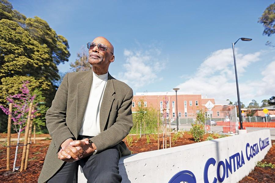 "Retired political science professor Leonard McNeil sits alongside a college sign on campus on March 7. McNeil reminisced of the time he and former CCC president McKinley Williams spent together ""dragging the main""on McDonald Avenue and 23rd Street in Richmond as Richmond High School seniors and as students at Contra Costa College."