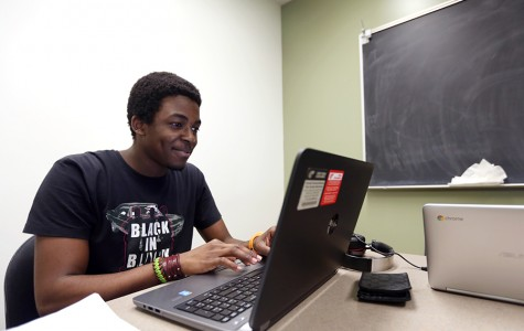 Engineering major Ogheneyengbame Akpojiyovbi uses one of the laptops now available for rent in the library. The laptops can be used for three hours at a time and can be picked up at the information desk.