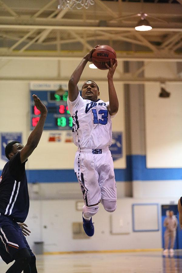 Comet guard Anthony Sullen flies past Hawkeye center Bakari Bradford for a layup during the round 2 Mens Basketball Regional Championship victory against Consummes River College on Friday in the Gymnasium.