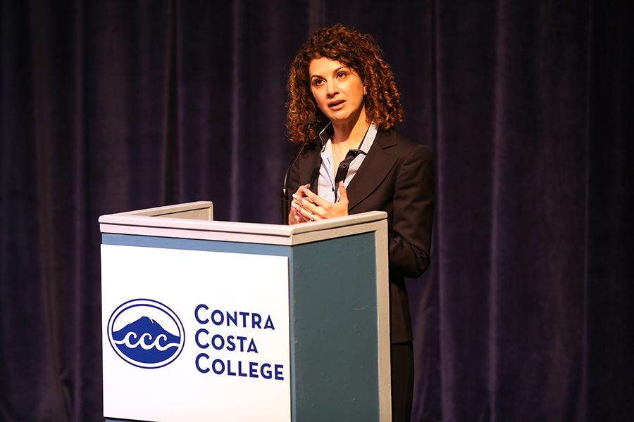 President Mojdeh Mehdizadeh speaks to members of audience, answering questions about her platform during the presidential forum on March 3 in the Knox Center.