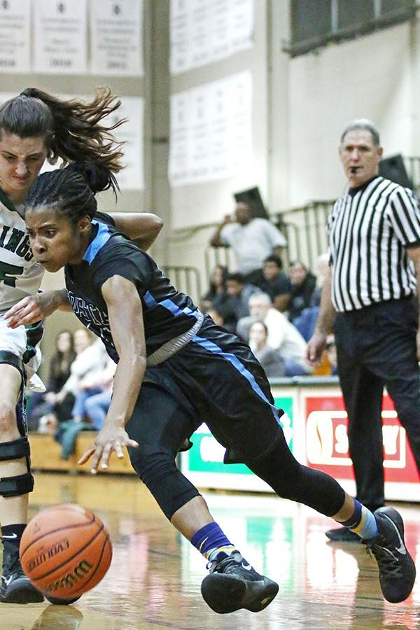 Comet guard Daizah Pounds drives past Viking forward Miranda Nelson during Contra Costa College's NorCal Regional playoff game against Diablo Valley College at DVC on Feb. 26.