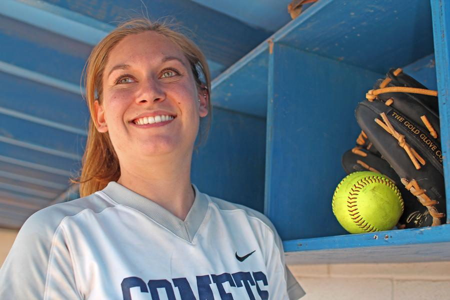 Comet pitcher Anna Palter lends supporting advice to her squad during a difficult season.