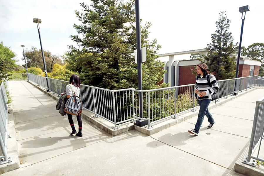 Two students walk across the bridge where two armed robbers held up Douglass Castro (not pictured) at 2:40 p.m. on April 5 between the Liberal Arts Building and Physical Sciences Building.