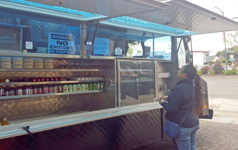 An El Cerrito resident places an order at Curbside Kitchen, outside of Barney McBears, on April 10. The food truck is parked next to the bar every Sunday.