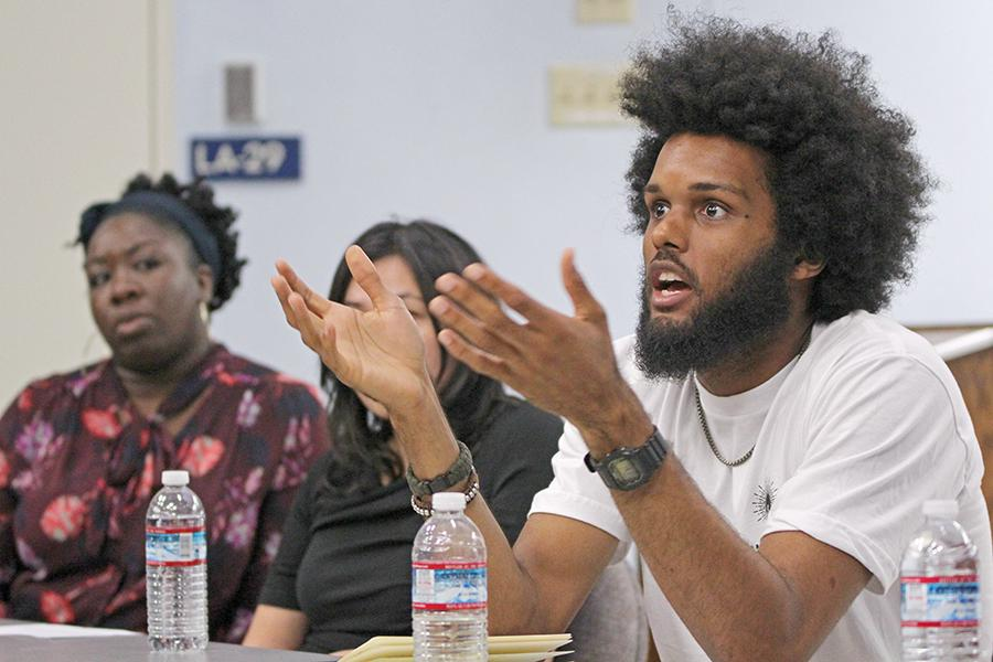 "Berkeley Copwatch	member Marcel Jones (right) speaks to the audience during the ""Mass Incarceration Panel"" event held in LA-100 on April 7."