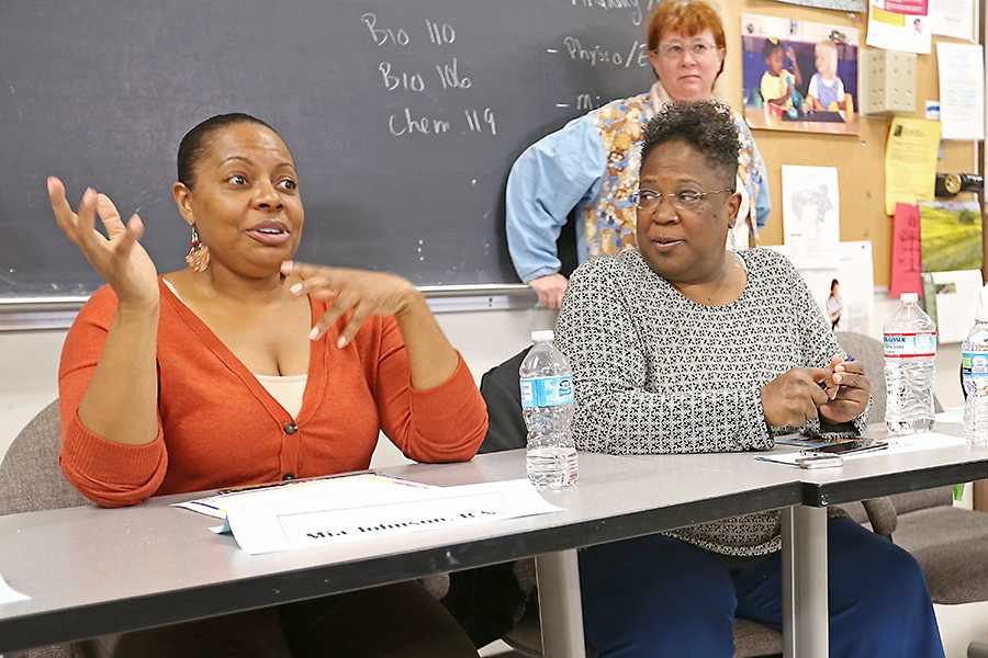 Registered nurse Mia Johnson (left) and Samuel Merritt College representative Sheri Holbrook speak to students about the challenges of entering a nursing program during the Nursing Symposium event in HS-101 on April 8.