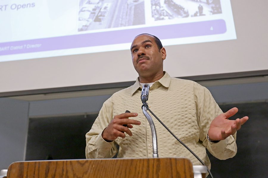 BART District 7 Director Zachary Mallet speaks to students about how the transportation agency plans to refurbish and improve its outdated stations and cars in LA-100 on May 11.