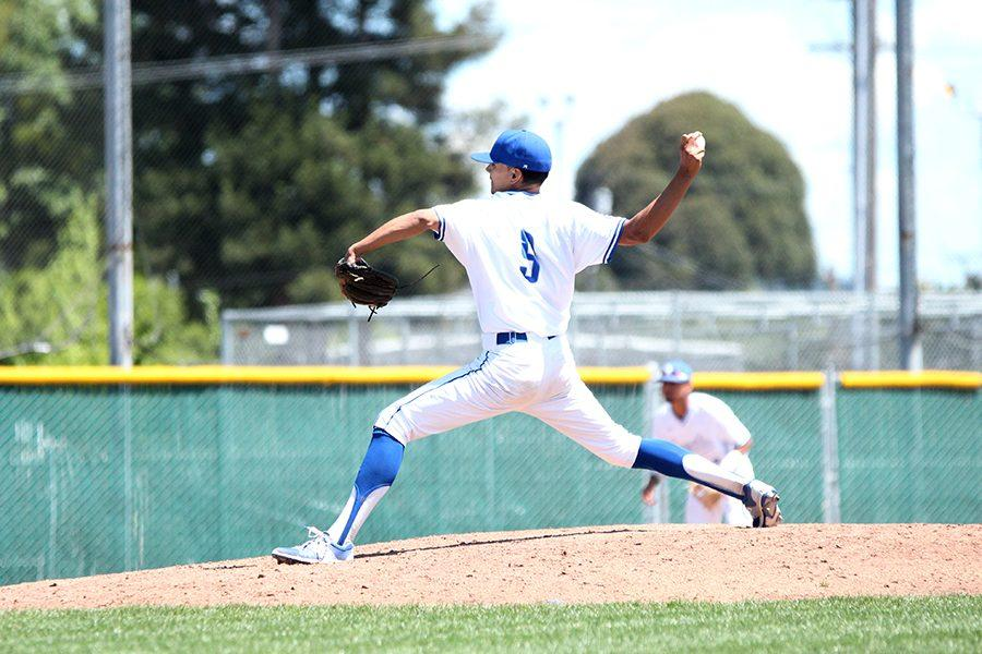 Comet pitcher Jake Dent unwinds a pitch during the Comets' 11-3 loss to Folsom Lake College at the Baseball Field on Saturday. Dent was unable to stay in the game due to issues with his right arm that began to affect his control.