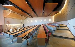 The lecture hall in the General Education Building features a drop down projection screen and dwarfs the LA-100 lecture hall in size comparison.