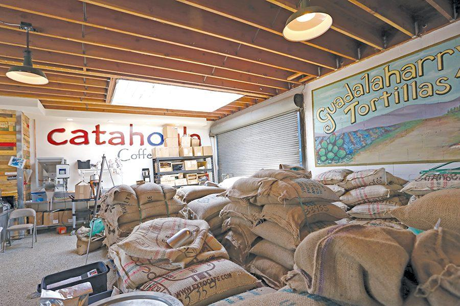 Burlap+sacks+of+coffee+sit+in+the+roasting+room+waiting+to+be+processed+at+Catahoula+Coffee+on+San+Pablo+Avenue+in+Richmond+on+Sunday.