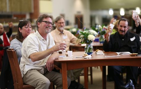 Automotive services professor Peter Lock (left) and others in attendance raise their glasses to salute Lock's time spent at the college during the annual Retirement Reception and Staff Reunion hosted in the Library and Learning Resources Center on May 6.