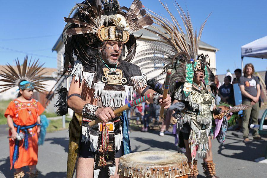 Dancers from Teokalli, meaning house of creation, perform an Aztec ceremony asking the land for permission to alter it during the Youth Service Day event along the Richmond Greenway at South 42nd Street and Ohio Avenue on Saturday.
