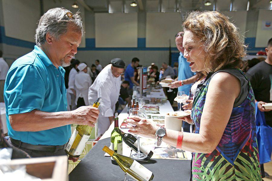 Richmond resident Darlene Drapkin  samples a glass of wine from the Grigich Hills Estates collection during the 9th Annual Food and Wine Event in the Gymnasium on Sunday.