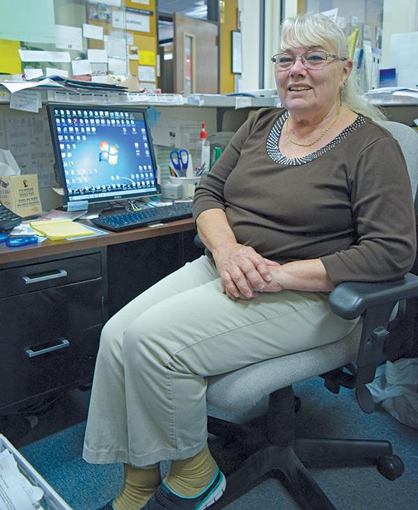 Nursing administrative secretary Diana Hall sits in her office in the Health Sciences Building on Friday. Hall will retire from her current position of serving nursing students in a full-time capacity for the past 16 years on June 20.