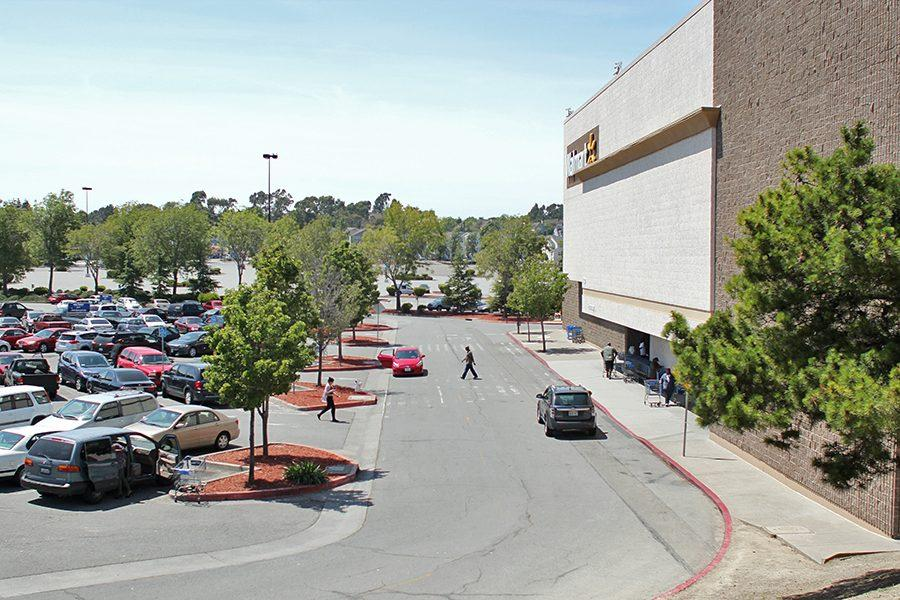 Shoppers travel to and from Wal-Mart on Monday. Hilltop Mall slipped into foreclosure in June 2013 after the former owner, Simon Property Group, Inc. failed to repay a loan that used the mall as collateral.