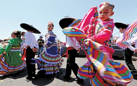 Dancers with Danza Azteca Guadalupana perform for the crowd during the Cinco de Mayo Festival on 23rd Street on Sunday.
