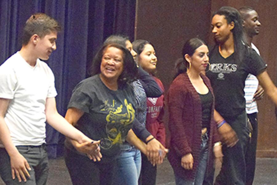 Drama professor Linda Jackson-Whitmore prepares to bow down with her class after performing various scenes and skits in one part of the drama department's open house for high school students on May 5 in the Knox Center.