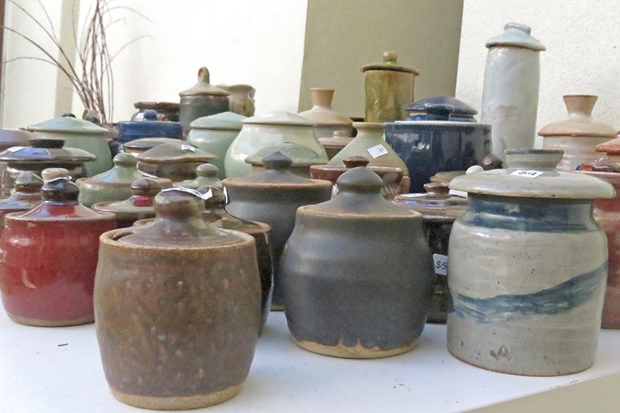 Student-made ceramics sit waiting to be purchased last week at the annual Pottery Event in the Art Building. All funds collected from the art sale go toward funding the fine and media arts department.