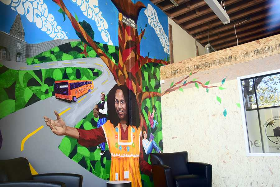 """The """"Freedom Expression"""" mural was unveiled in the lobby of the Re-Entry Success Center in Richmond on Aug. 14. The mural emphasizes the welcoming spirit of the center."""