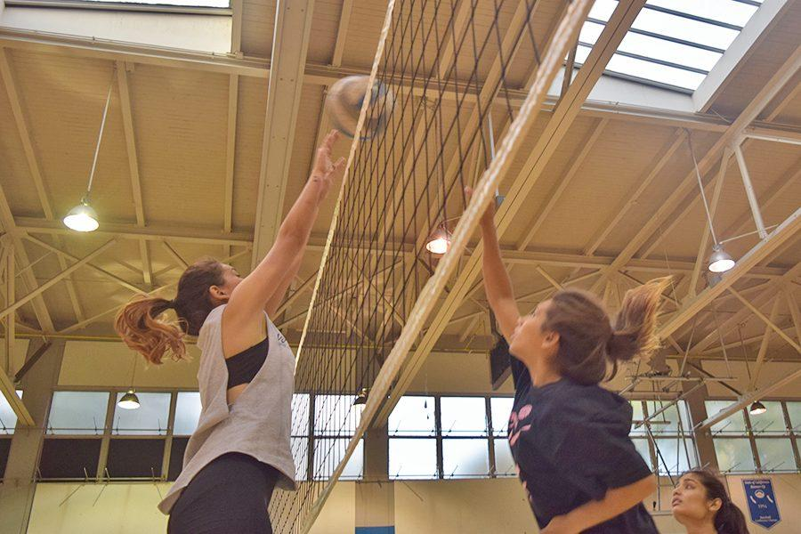 Defensive specialist Jacqueline Tianero hits the ball over the net during volleyball practice in the Gymnasium on Monday.