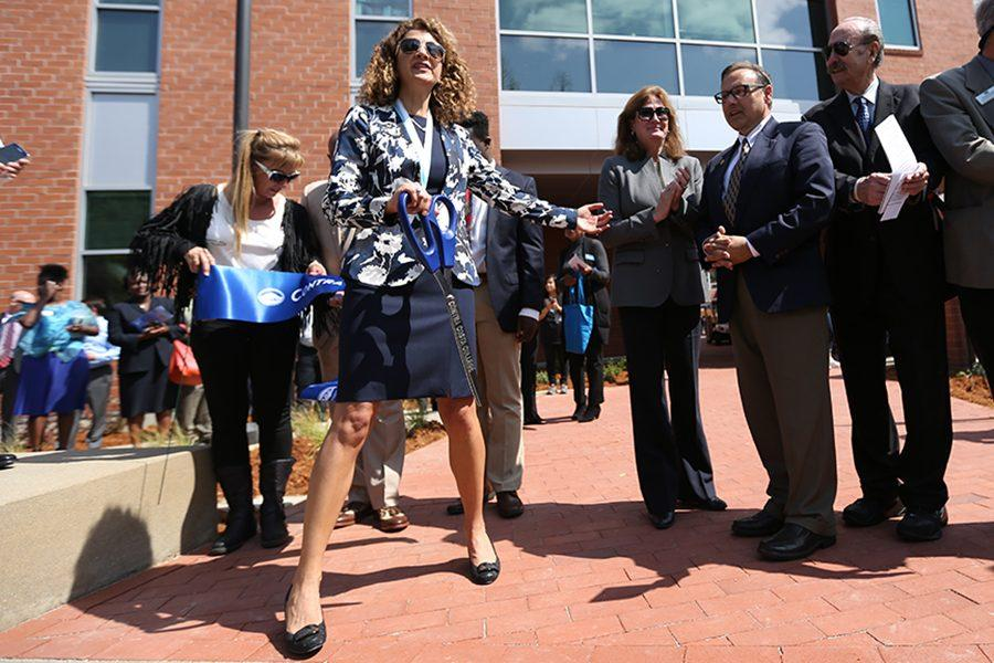 College President Mojdeh Mehdizadeh cuts the ribbon during the new college center and presidential investiture event in the Campus Center Plaza  Amphitheater on Tuesday.