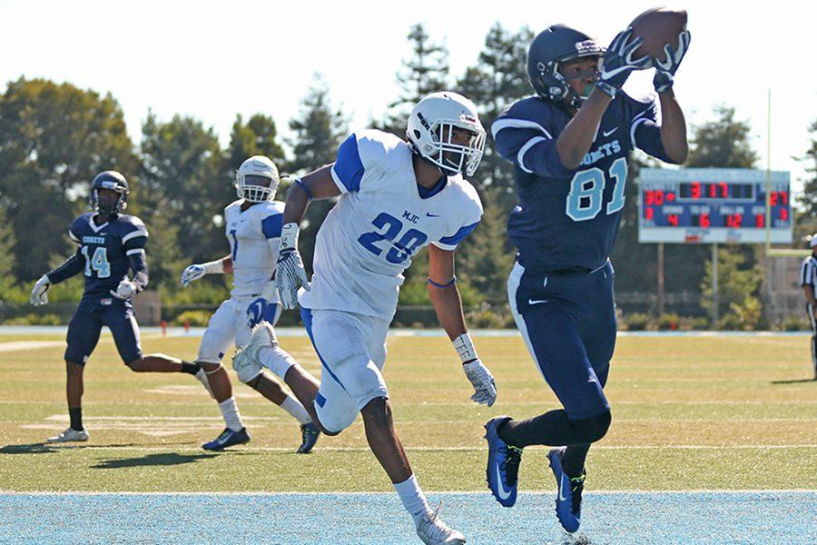 Comet wide receiver Marquis Pippins catches the ball for a touchdown during CCC's 42-34 win against Modesto Junior College at Comet Stadium on Saturday.
