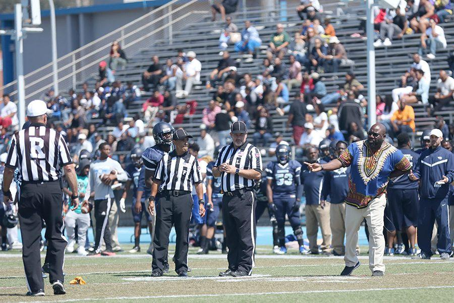 Football coach Alonzo Carter seeks clarification from the referees after a penalty call against the Comets during CCC's 17-14 loss to Sacramento City College at Comet Stadium on Saturday.
