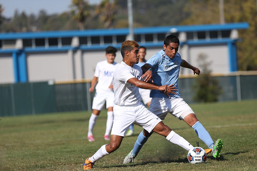 Comet forward Saul Munoz and Pirate midfielder Angel Hernandez battle for possession during CCC's game against Modesto Junior College at the Soccer Field on Sep. 6.