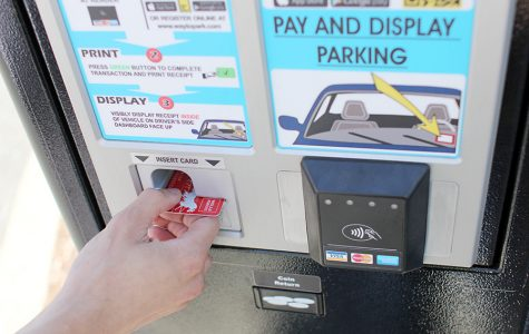 Recently installed parking meters have replaced the old out of service yellow parking meters. Students may purchase daily passes for $3 through debit cards, Apple Pay and coins.