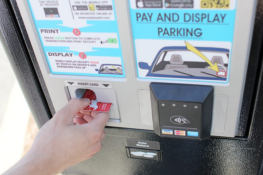 Recently+installed+parking+meters+have+replaced+the+old+out+of+service+yellow+parking+meters.+Students+may+purchase+daily+passes+for+%243+through+debit+cards%2C+Apple+Pay+and+coins.