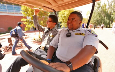 Administration of justice major Daquan Jackson (right) wears a new police aide uniform on patrol with fellow police aide Juan Flores (left) in the Campus Center Plaza on Monday.