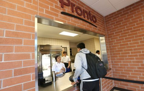 Criminal justice major Aaron Hernandez (right) puts in his order to culinary arts major Elizabeth Rago (left) at Pronto in the Student and Administration Building on Aug. 29.