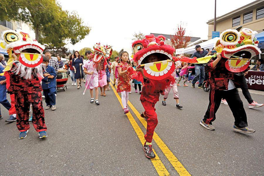 Participants with Cornell Elementary Afterschool Program perform for viewers during the Solano Stroll on Solano Avenue in Albany on Sunday.