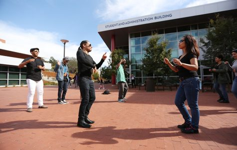Zumba instructor Oscar Ivan Solano (left) and chemistry professor Seti Sidharta (right) demonstrate dance moves during the Bachata on the Yard event in the Campus Center Plaza on Oct. 12.
