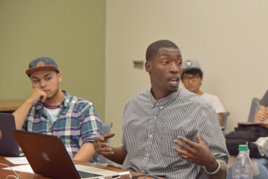 Student Life Coordinator Joel Nickelson-Shanks talks to club representatives during the Inter-Club Council (ICC) meeting in the SA-100 on Sept.  27. The ICC meets every Tuesday to discuss club activities and other agenda items.