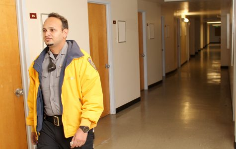 Police aide Jagrwop Singh makes his rounds in the basement of the LA Building on Monday. The building is empty but remains open to provide elevator access to students with disabilities.