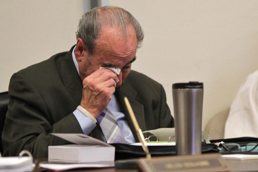 District board Trustee John Marquez weeps after sharing a story about fellow Trustee John T. Nejedly during the district Governing Board meeting in Martinez on Oct. 12.