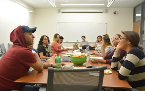 Psychology major Mauricio Duarte (left) and computer science major Marcella Navas (right) listen to club President Esmeralda Martinez during the Puente Club meeting on Sept. 21 in the SA-100.