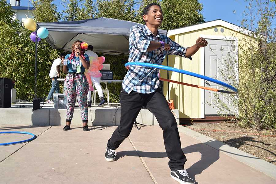 A Ryse member hula-hoops in the backyard during the RYSE Center's Open House   on Sept. 16