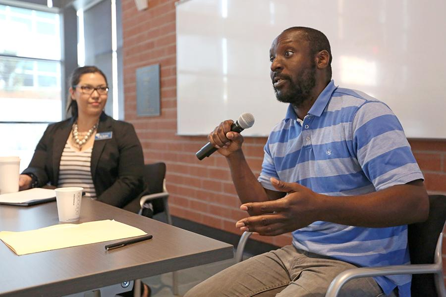 Molecular and cell biologist Malik Francis speaks to students during the second installment of the Adelante STEM Academy's STEM Café series.