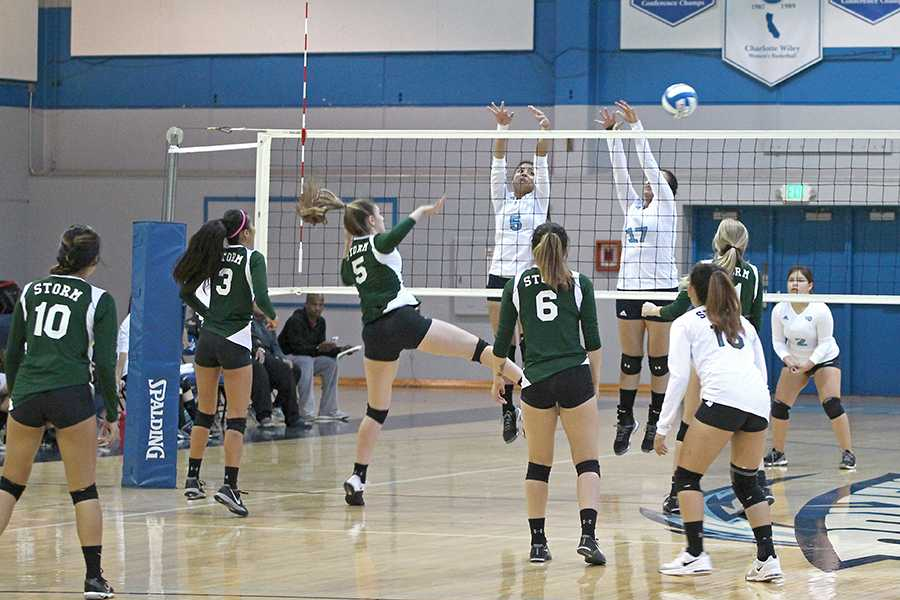 Storm outside hitter Mariah Leal (middle left) hits the ball past Comet blockers Jacqueline Tianero and Alejandra Galvez during CCC's 3-0 loss against Napa Valley College on Friday in the Gymnasium.