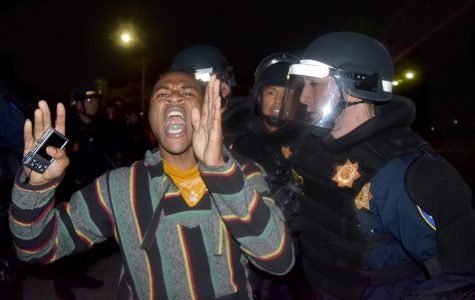 As he is arrested by Oakland Police, a man yells to the crowd of fellow protesters blocking the I-580 freeway during the protest against the election of Donald Trump as president in downtown Oakland, California on Nov. 10, 2016.