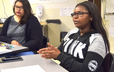 Film major Courtney Chappell (right) speaks to English major Mickayla Burgos and the rest of the Student In Action club members in AA-219 on Oct. 12.