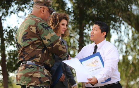 The Armed Services Support Group President Leon Watkins (left) and President Mojdeh Mehdizadeh (middle) receive a letter of appreciation from District 15 Assembly member Tony Thurmond's representative during the opening ceremony of the Veterans Resource Center in the Amphitheater on Thursday.