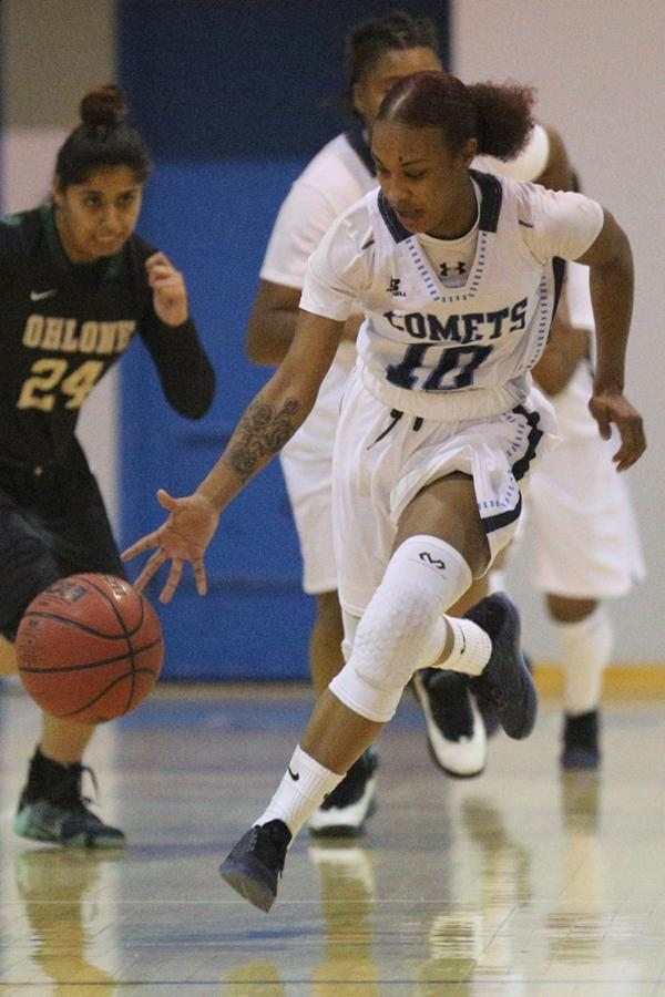 Comet point guard Azanae Lewis dribbles up the court during the 23rd Annual Comet Classic women's basketball tournament in the Gymnasium on Friday.