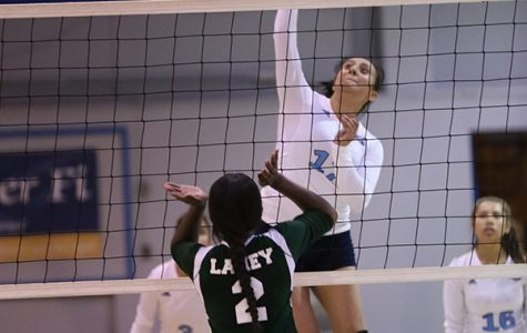 Comet right setter Joshleen Ayson and middle blocker Justine Ayson (right) deny a spike by Laney outside hitter Claire McKee during CCC's 3-0 win over Laney College in the Gymnasium on Sept. 20.