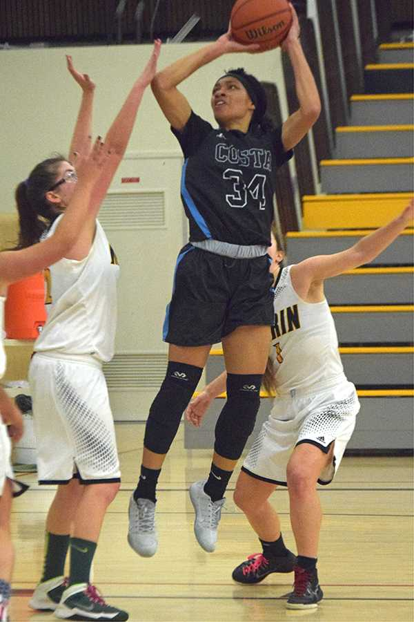 Comet forward Keyauna Harrison shoots over Mariner forward Regan Andel during a Contra Costa College away win over College of Marin on Friday.